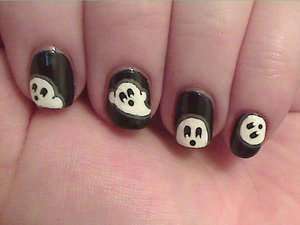 Just some sweet little ghosts painted with acrylic paint over Sally Hansen Black Heart