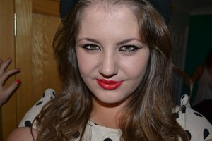 Extreme cat eye make up with a red lip.