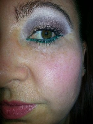 Neutral with a green under eye liner.