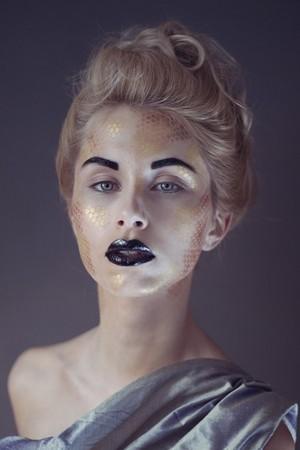 black eyebrows, black glossy lips, gold pattern, avant garde