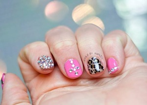 """very short acrylic tip overlay with my signature leopard print nail art (highly requested) featuring a fully blinged out nail over OPI """"Bring on the Bling"""" polish on the index finger. I did my own acrylics and nail art and the acrylic on my right hand was definitely a challenge but i love how they turned out :)"""