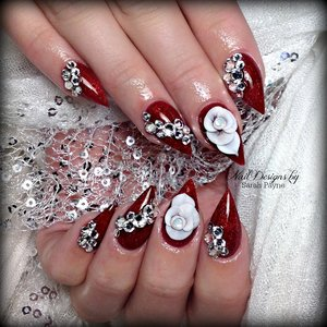 Red pointy nails with 3D roses and bling