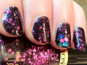 My first try at nail art or nail-dazzling, if you will. A manicure with Revlon Scandalous, bringing goth and glitz together!