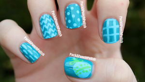 The blue is Sinful Colors Savage and the designs are done with acrylic paint.  http://packapunchpolish.blogspot.com/2012/09/simple-baby-shower-nail-art.html