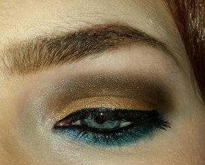 The gold and brown are from the Sephora IT Color Spectrum Palette. The teal eyeliner is Urban Decay in the shade Junkie topped with Junkie eyeshadow.