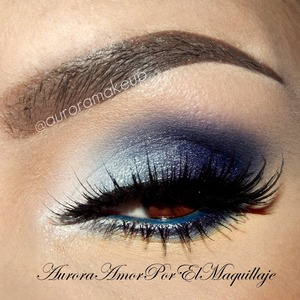 instagram @auroramakeup GET THE LOOK: 1. Apply Eye Shadow Base 2. Place & blend Pressed Eye Shadow TWILIGHT on the crease Place on the outer mobile eyelid & below lower lashes Pressed Eye Shadow MIDNIGHT  3. Hightlight inner corner and brow bone with Pressed Eye Shadow LIQUID and place since inner corner up to center of the eyelid Pressed Eye Shadow CRYSTAL BLUE If you want add some glitter in the inner corner with GLITTER ADHESIVE & Glitter Pot in CELEBRATE 4. Line your top lashes with Gel Eyeliner in LITTLE BLACK DRESS & apply in the waterline Khol Eyeliner ELECTRIC BLUE 5. Add false lashes NOIR FAIRY in BLACK by @houseoflashes and apply Lustrafy Mascara in BLACKOUT in top and lower lashes