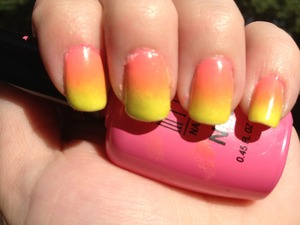This photo doesn't really seem to do the colors justice. It's hard to see the pink at the base...but hey, I think it still came out pretty good. This is my second attempt at doing gradient nails and I think I'm starting to get the hang of it!