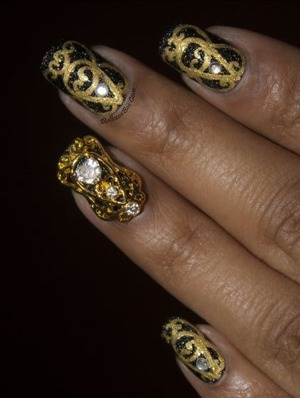 Find the tutorial on the blog: http://www.bellezzabee.com/2013/12/royal-medallion-manicure-tutorial.html