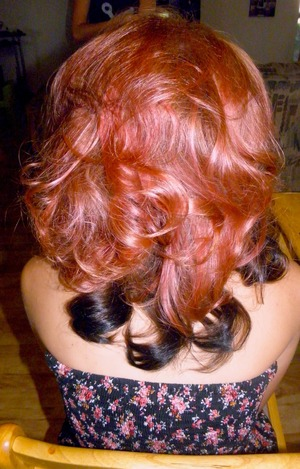 Voluminous Hairs using hot rollers, and teasing comb.