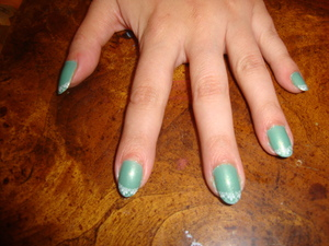 Sinful Colors polish in Mint Apple and white konad lace tips