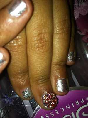 Just did my daughter nails with sliver moon nail polish and added the gems