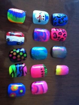 My collection of designs I have created on fake nails. I'm 11 (: