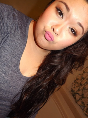 Matte pink lips with subtle gold eyeshadow.