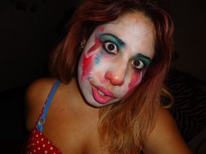 A faded, more creepy version of The Devil's Carnival Clown