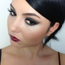 Smokey eye and bold lip.