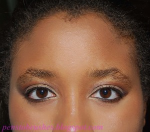 Bronze eye makeup.