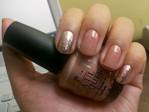Nude polish (OPI Dulce de Leche) paired with glittered accent nails (OPI Designer...De Better! and China Glaze Glam)