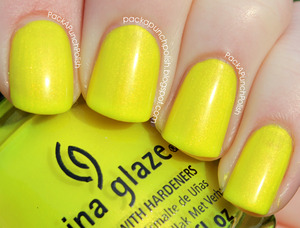 Sun-Kissed by China Glaze is a super bright neon yellow shimmer. It's part of the Summer Neons Collection. This is 2 coats without top coat.