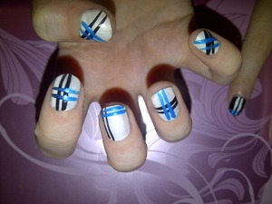 white nails with blue and black stripes
