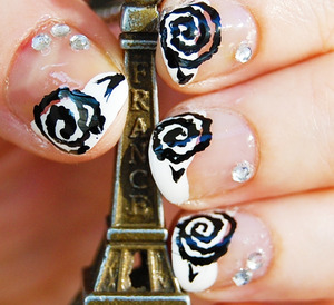 French Rose (Floral series #4)  Tutorial: http://www.youtube.com/watch?v=wB4cgwcu0OA I used: base coat, black and white colors, toothpich and thin brush + rhinestones, and top coat. For especific brands/names please watch my tutorial.