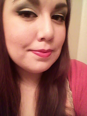 """This is my first shot at trying winged liner on myself! :) my eyeliner is """"tarte amazonian clay egyptian kohl eyeliner in black."""" And the red on my lips is L'oreals """"blazing sangria"""""""