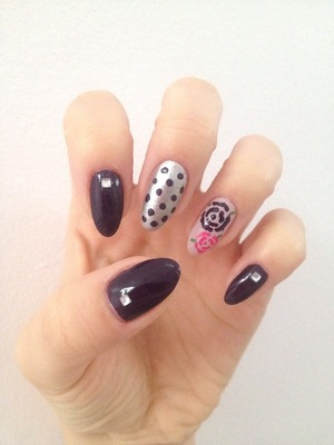Natural stiletto nails with gems and free hand drawn dots and roses