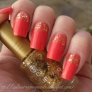 Coral nails with gold sparkles