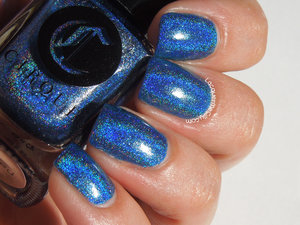 Gorgeous holographic jewel toned blue by Cirque. More photos and info can be found on my blog: http://www.lacquermesilly.com/2014/08/30/cirque-bejeweled/