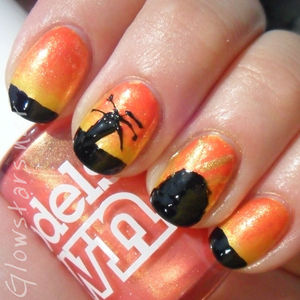 A mani showing the silhouette of a summer sunset. To find out more visit http://glowstars.net/lacquer-obsession/2012/09/summer-sunset