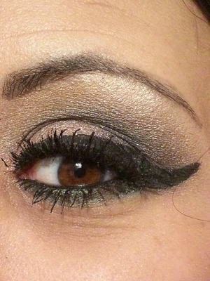 Smoky Eye done with Urban Decay Eye Shadows.  I used Midnight Rodeo on my inner parts of both my lids. Then, I  lightly blended Pistol into my crease and then blended Gunmetal on top of that.  I used a pencil brush to add more Gunmetal onto the outer parts of both my lids and then used a shading brush where Gunmetal meets Midnight Rodeo.  Last, I used an angled eye shadow brush to apply Blunt up by my brow area.  Now you just blend all the colors into each other to eliminate any harsh lines.  To finish the look I lined my lower lash line with Shattered then took my pencil brush and added oil slick on top of that which created that shimmery green color.