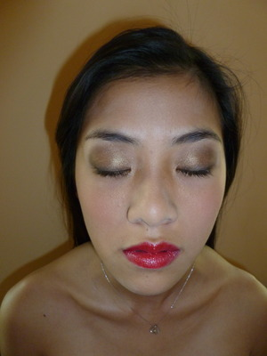 Your basic brown smokey eye and red lip combo
