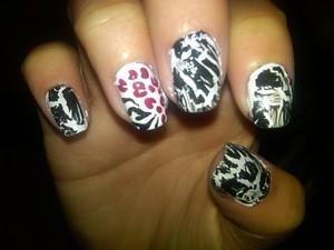 my friends nails i did black crakle w/ a cheetah/zebra print