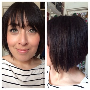 """Bangs help cover a large forehead and the layering and thinning keeps any """"mushroom"""" shape from happening on such thick hair."""