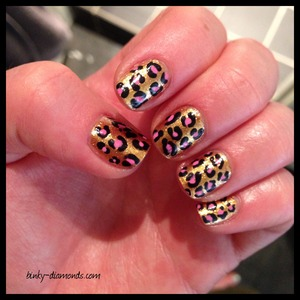 Gold and pink leopard print nail art