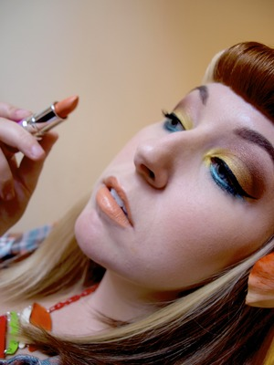 Orange Crush eyes, and Lipstick is Cosmopop by Lime Crime