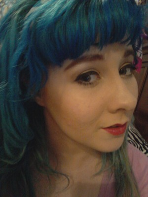 I curled my day old hair and a wing eyeliner