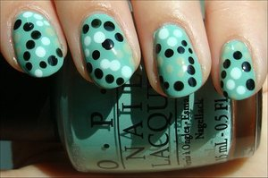Dotty Nails Nail tutorial & more photos here: http://www.swatchandlearn.com/nail-art-tutorial-dotty-nails/