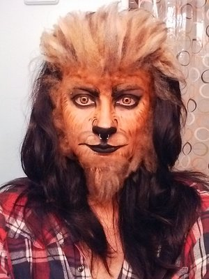 Face paint, homemade fur, crazy contacts and hair spray.