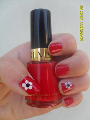 Yes I painted my nails AGAIN this week haha :D I painted them because I am playing Grace in the musical Annie so I thought it was appropriate that an assistant had nice red nails. I attempted my first flower nail art too! They look better from farther awa