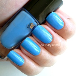 a vibrant lake-water blue, it's a medium tone, not too pastel and not too bright. http://www.beautybykrystal.com/2013/05/lancome-aqua-bleu.html
