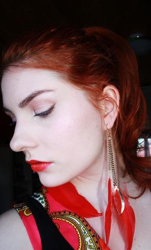Pretty nude eye makeup and on my lips MAC's So Chaud lipstick.