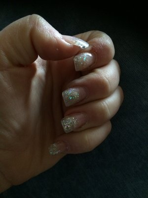 Gel nails with gel sparkled tips that are doubled layered with gel