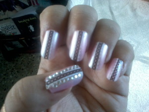 they were plain pink nails with bLack design@! I Stuck some Rhinestones to glamify them! Ta~dA !