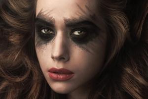 black eye makeup, copper lip, avant garde