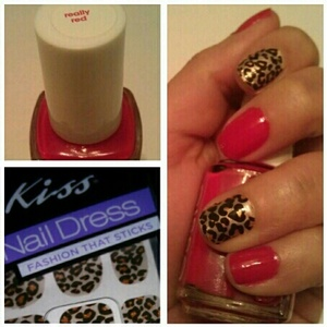 """Essie """"really red"""" & Kiss Nail Dress """"KDS10""""cheetah print stickers alternated on each finger."""
