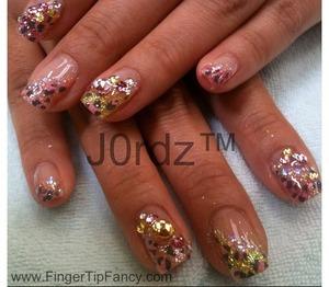 http://fingertipfancy.com/pink-orange-yellow-cheetah-nails