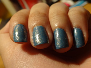 """I used both Essie nail polishes that I had lying around unopened. I have """"As Gold as It Gets"""" layered over """"Coat Azure."""" I do have a picture of Coat Azure alone so if you're interested in that, go check that out but I really love this combo. The gold flecks are not obnoxious or obvious but it stands out beautifully in the sun."""