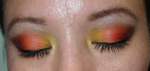 close up  inner third of eyelid is a mate yellow taxi from Mark new palette superflip .  middle of eyelid is orange from trio Shangri-la from NYX outter eyelid is  M.I.A.  a deep chocolate brown from the new Urban Decay 15 year anniversary palette inner c