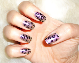 while it doesn't show up much in these pics, this is a duo-chrome polish....pink/purple/green. pretty neat. i instantly thought of those lisa frank designs and decided to add some animal print ^^