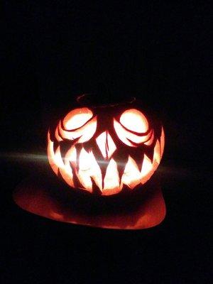 Carved a creepy jack-o-lantern XD got some tasty pumpkin seeds out of it!